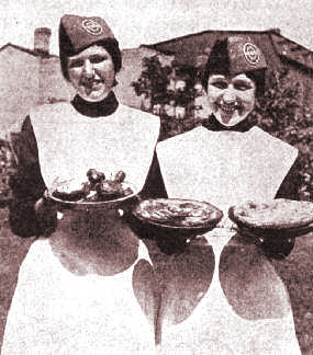 Female Salvation Army volunteers with baked goods, c. 1917-1919.